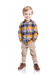 Fototapeta Cute little boy posing with the hands in his pockets, isolated over white background