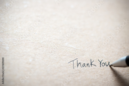 Hand writing thank you on piece of old grunge paper Canvas Print