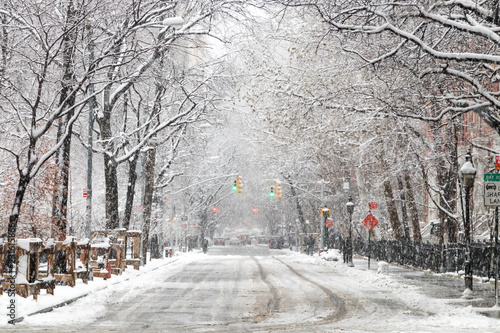 Fototapeten New York Snow covered street along Washington Square Park after a nor'easter snow storm in New York City