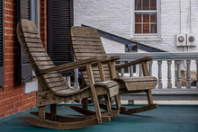 Wooden Rocking Chair On Old Colonial Patio In The USA