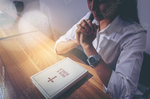 woman praying on holy bible before working in the morning Canvas Print