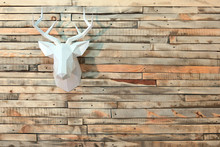 Paper Moose Head Hanging On The Wall With A View Of The Wooden Boards. Copy Space.