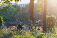 A Man Take A Nap In The Forest In Summer With His Bicycle