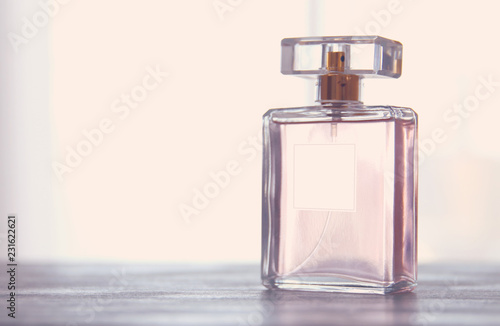 Obraz Image of elegant perfume bottle. back light photo. vintage filtered image. - fototapety do salonu