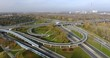 Cars Go Through The Highway Intersection. Aerial, Panorama, Time Lapse