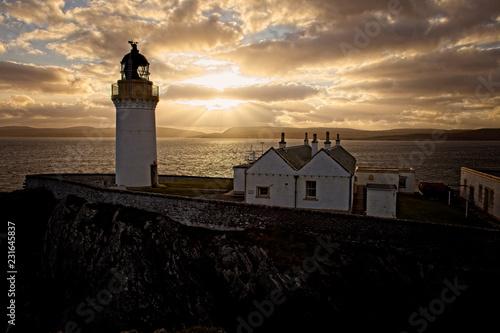 Montage in der Fensternische Leuchtturm Sun setting over Bressay Lighthouse, Bressay, Shetland, Scotland, UK.