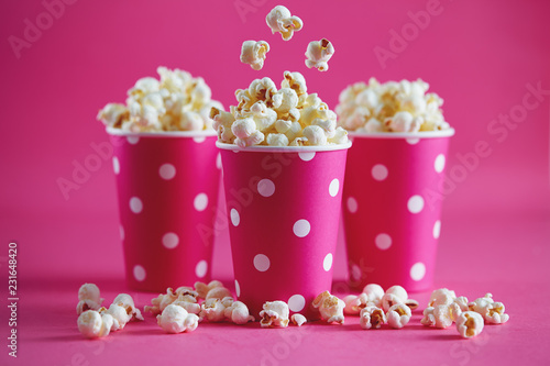 Pink polka dot paper cups with tasty popcorn.