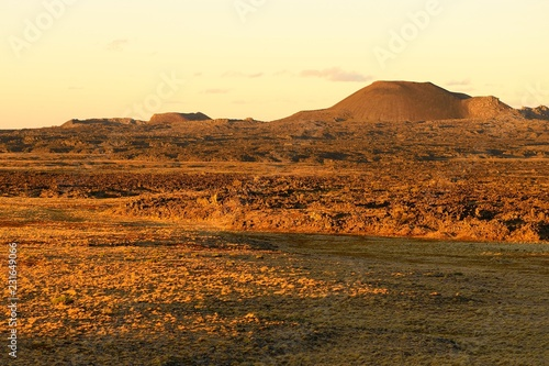 Volcanic landscape with volcanic cones in the evening sun, Pali Aike National Park, Magallanes Province, Chile, South America