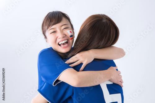 Photo 抱き合う女性サポーター