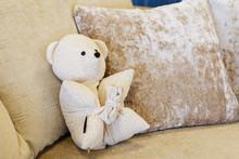 White Teddy Bear On White Couc...