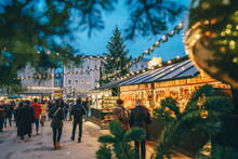 Salzburg Christmas Market Seen Trough A Christmas Tree Branches