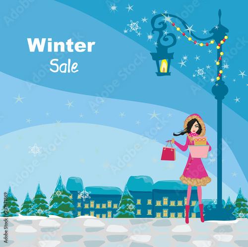 Fotografia  Beautiful girl on winter shopping, card