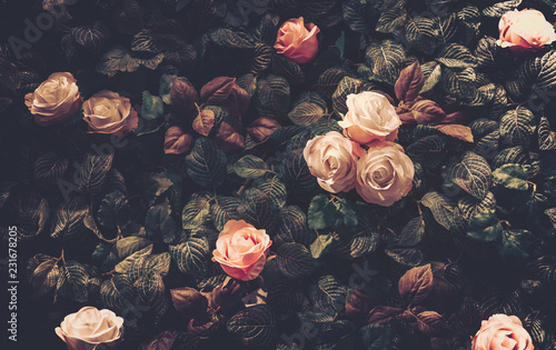 Foto op Canvas Retro Artificial Flowers Wall for Background in vintage style