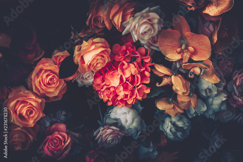 Foto op Canvas Roses Artificial Flowers Wall for Background in vintage style