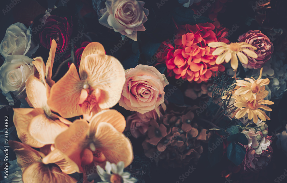 Fototapeta Artificial Flowers Wall for Background in vintage style