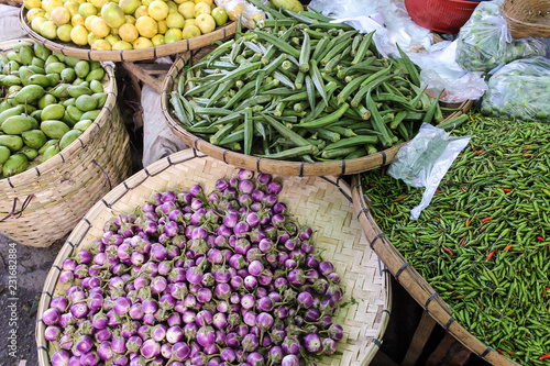 Fresh small Eggplants, Beans and Chillies on a local Farmers