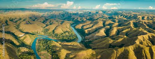 Fotografie, Obraz  Mountain green hills panorama with curvy river, Merdeka Hill, Bukit Wairinding, East Sumba, Indonesia