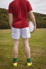 Rugby Player Standing With Rugby Ball In The Field