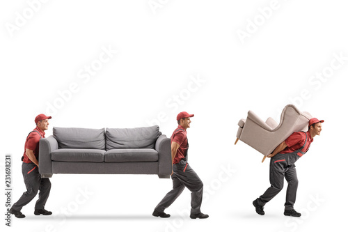 Obraz Movers carrying a couch and an armchair - fototapety do salonu