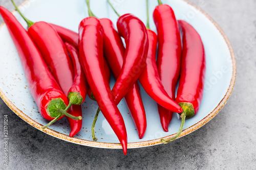 Keuken foto achterwand Aromatische Chili cayenne pepper on grey background.