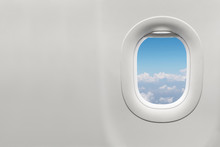 Isolated Airplane Window With Blue Sky