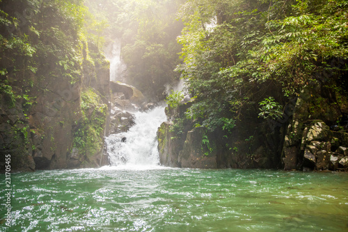 Spoed Foto op Canvas Asia land Mountain waterfall in Sunny day.