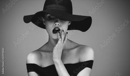 Fototapeta Flirty elegant female in black and white obraz