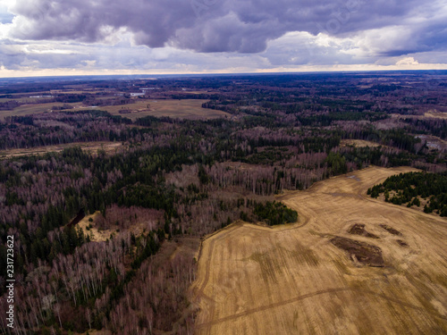 Deurstickers Chocoladebruin drone image. aerial view of rural area with fields and forests with river and water reflections
