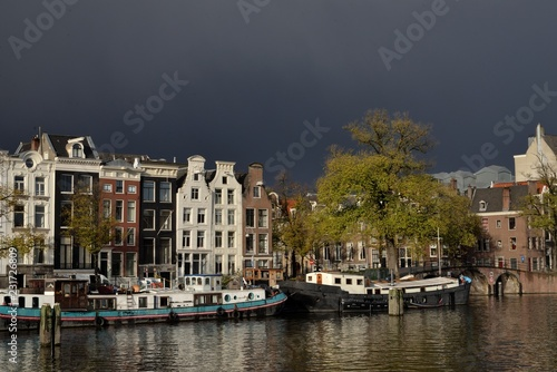 Staande foto Rotterdam House along the river in Amsterdam