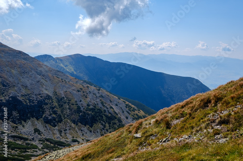 Spoed Foto op Canvas Blauwe hemel rocky mountain tops with hiking trails in autumn in Slovakian Tatra western Carpathian