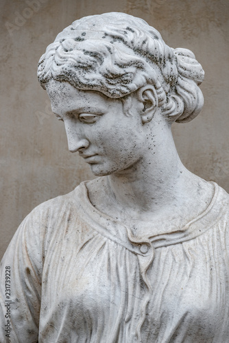 Spoed Foto op Canvas Historisch mon. Ancient statue of sensual Greek renaissance era woman with a flower, Potsdam, Germany, details, closeup
