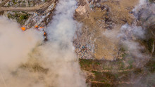 Aerial View Of Illegal Landfill In The Forest. Waste Incineration, Environmental Issue, Heavy Junk Smoke. Environmental Pollution Aft.