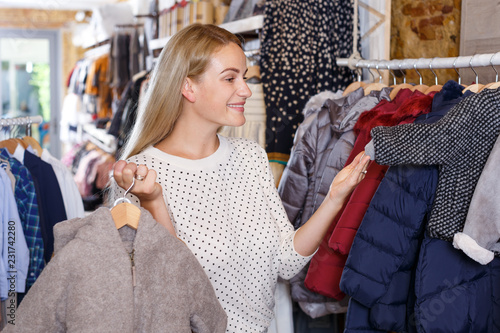 49b3d2a34c Woman shopping in kids clothing store - Buy this stock photo and ...