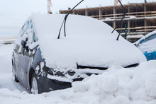 The Cars On The Parking Under Snow