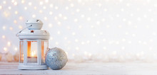White Lantern With Candle And Silver Ball - Christmas Decoration. Banner.