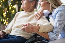 A Senior Woman In Wheelchair W...