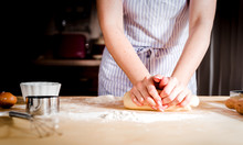 Female Hands Making Dough On W...