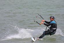 Kitesurfer Riding Board