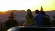 3 Teens Sit On Car And Watch The Sunset Together