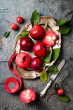 Still Life With Apples On Vintage Plate Over Gray Table, Top View. Fresh Red Apples Baya Marisa With Leaves.