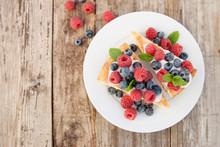 Homemade Cheesecake With Fresh Berries And Mint For Dessert - Healthy Organic Summer Dessert Pie Cheesecake.