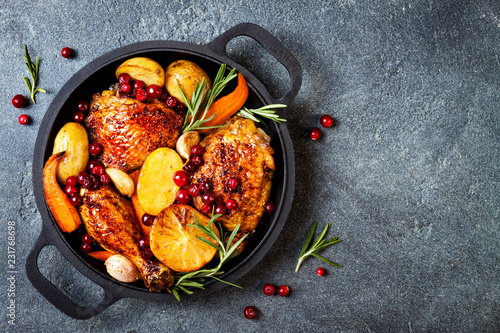 Roasted chicken legs with root vegetables, lemon, garlic, cranberry and rosemary Poster Mural XXL