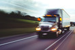 canvas print picture - Semi truck on highway concept with motion blur