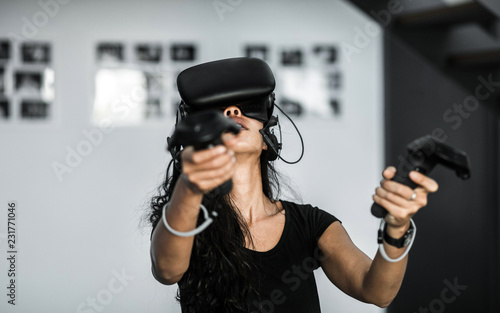 South-East asian girl playing VR game - Buy this stock photo