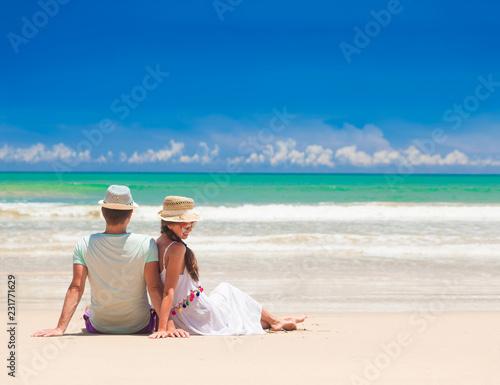 young couple on their honeymoon having fun by tropical beach Obraz na płótnie