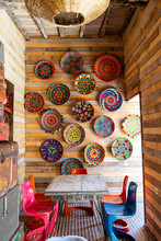 Colorful Dishes Hung On A Wall...