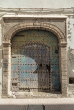 Arched Turquoise Metal Door