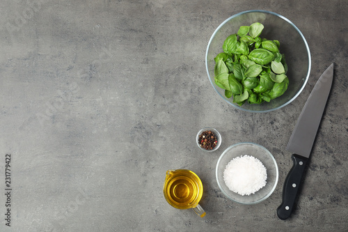 Keuken foto achterwand Aromatische Flat lay composition with fresh basil leaves and space for text on table