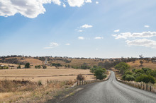Australian Outback Countryside Road With Farms On The Side