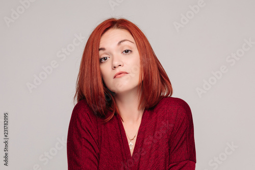 Photo Front view of beautiful business woman wearing in red with short haircut having disregard and passive emotion, looking at camera